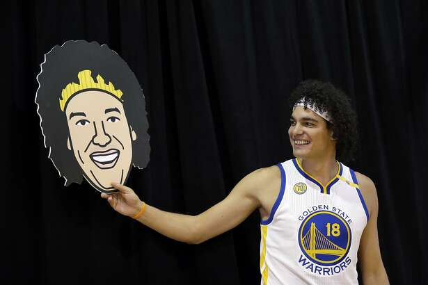 Golden State Warriors' Anderson Varejao (18) poses with a cutout with his likeness during NBA basketball media day Monday, Sept. 26, 2016, in Oakland, Calif. (AP Photo/Marcio Jose Sanchez)