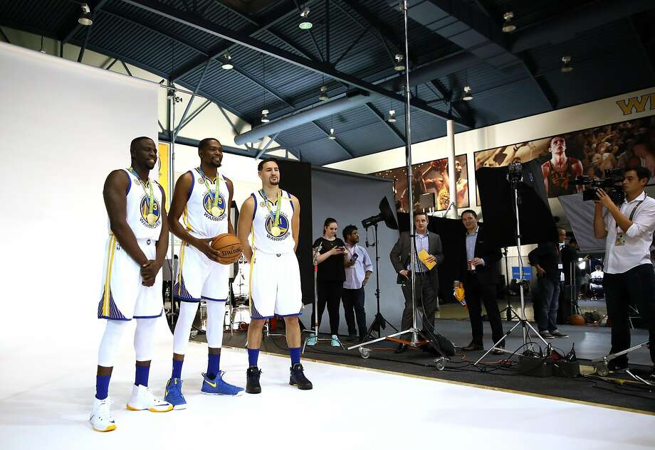 OAKLAND, CA - SEPTEMBER 26:  Draymond Green #23, Kevin Durant #35, and Klay Thompson #11 of the Golden State Warriors pose with their Olympic Gold medals for NBA team photographer Noah Graham during the Golden State Warriors Media Day at the Warriors Practice Facility on September 26, 2016 in Oakland, California.  (Photo by Ezra Shaw/Getty Images) Photo: Ezra Shaw, Getty Images