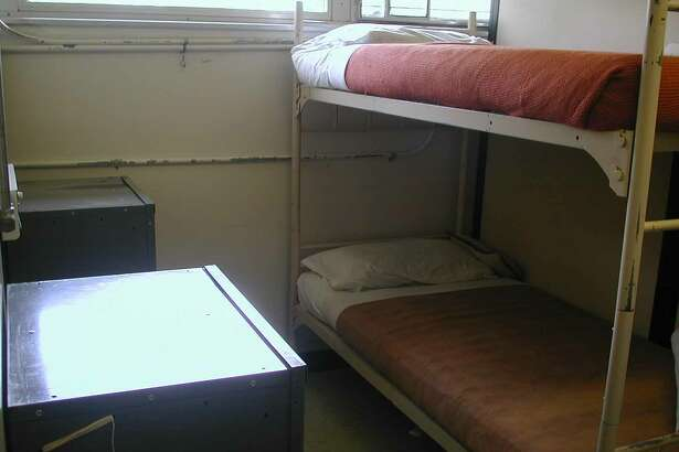 This is an undated photo of a two-person cubicle at the women's Federal Correctional Institution in Danbury.