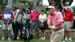 Arnold Palmer sends his drive off the No. 10 tee box at Oak Hills Country Club on Oct. 15, 2003, during a pro-am event.