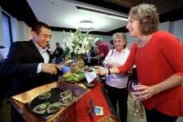 Agustin Escalante, of No. 2 restaurant Hugo's, served tacos de lengua con chintextle to Leslyn Greenier.
