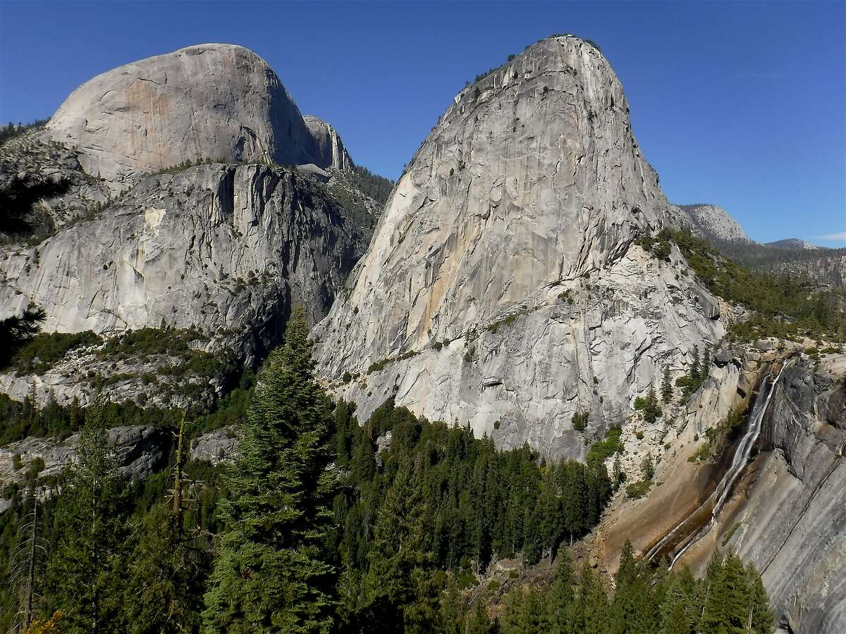 On a loop hike from Yosemite Valley, you can get this view of 7,076-foot Liberty Cap, the little-seen south flank of 8,842-foot Half Dome and it shoulder, and below to 594-foot Nevada Fall.