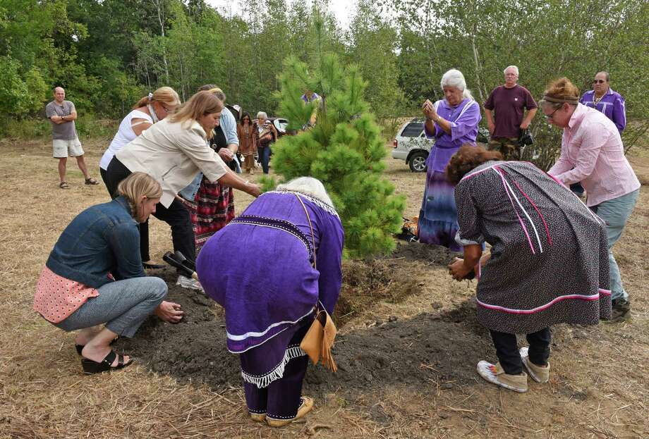 Women in attendance give the first blessing during a symbolic tree planting ceremony as Brookfield Renewable Energy Company and the Hiawatha Institute for Indigenous Knowledge will mark the formal transfer of culturally vital property on the north shore of the Mohawk River on Friday Sept. 23, 2016 in Waterford, N.Y. (Michael P. Farrell/Times Union) Photo: Michael P. Farrell / 40038133A