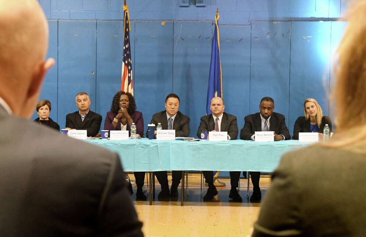 Members of Fairfield County?'s state delegation from left, Livvy Floren, Carlo Leone, Patricia Billie Miller, William Tong, Dan Fox, Terry Adams and Caroline Simmons host a special Community Action Conference at the Chester Addison Community Center in Stamford, Conn., Monday, Sept. 26, 2016. Here they listen as Mike Lawlor, left, Under Secretary for Criminal Justice Policy and Planning, and Meaghan McDonald, Strategic Operations and Policy Specialist at John Jay College of Criminal Justice, right, discuss the topic. Local leaders including Mayor David Martin and Chief of Police Jonathan Fontneau, members of the clergy and religious institutions, community leaders and social service organizations, and other advocacy groups including the NAACP focused on methods to prevent gun violence in Stamford. The conversation touched on strategies that have worked in other cities and how to implement similar strategies locally.
