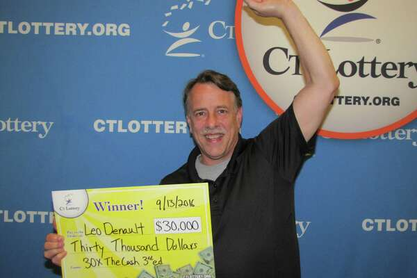 Leo Denault of New Milford celebrates the $30,000 prize he won playing the Connecticut Lottery.