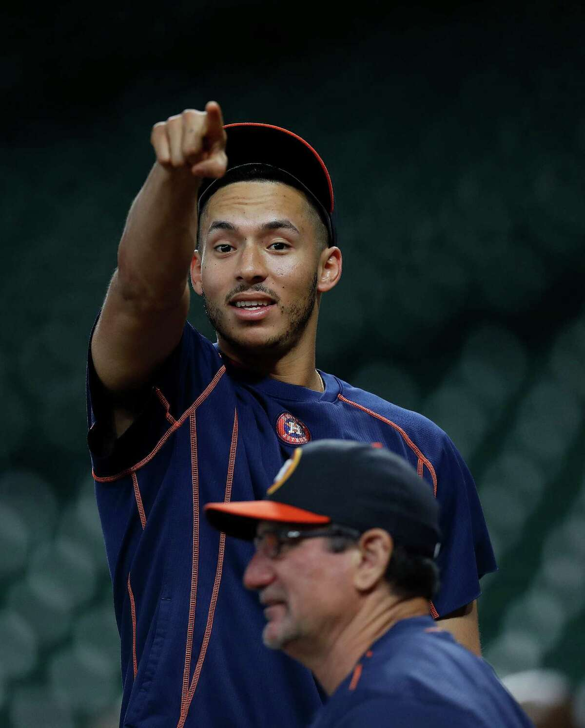 Houston Astros shortstop Carlos Correa smiles as he sees someone he knows during batting practice before the start of an MLB game at Minute Maid Park, Monday, Sept. 26, 2016 in Houston.