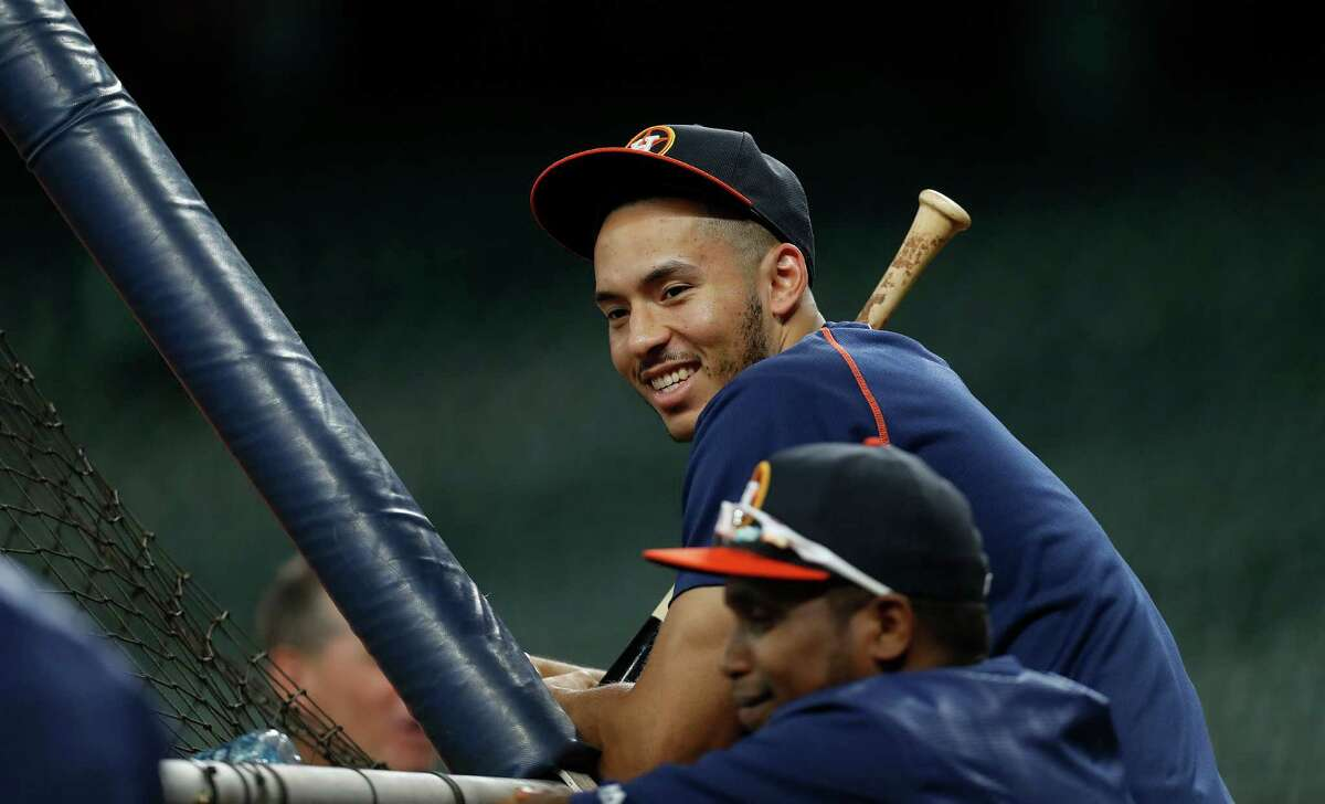 Houston Astros shortstop Carlos Correa smiles during batting practice before the start of an MLB game at Minute Maid Park, Monday, Sept. 26, 2016 in Houston.