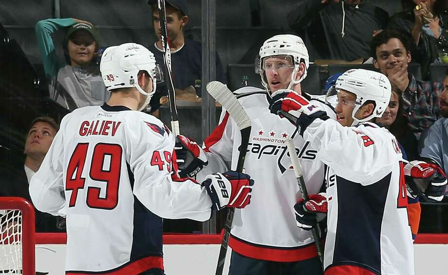 NEW YORK, NY - SEPTEMBER 28: Stanislav Galiev #49, Sean Collins #53 and Carter Camper #48 of the Washington Capitals celebrate a goal by Collins at 2:48 of the second period against the New York Islanders at the Barclays Center on September 28, 2015 in Brooklyn borough of New York City.  (Photo by Bruce Bennett/Getty Images) ORG XMIT: 573902549 ORG XMIT: ALB1509282044361581 Photo: Bruce Bennett / 2015 Getty Images