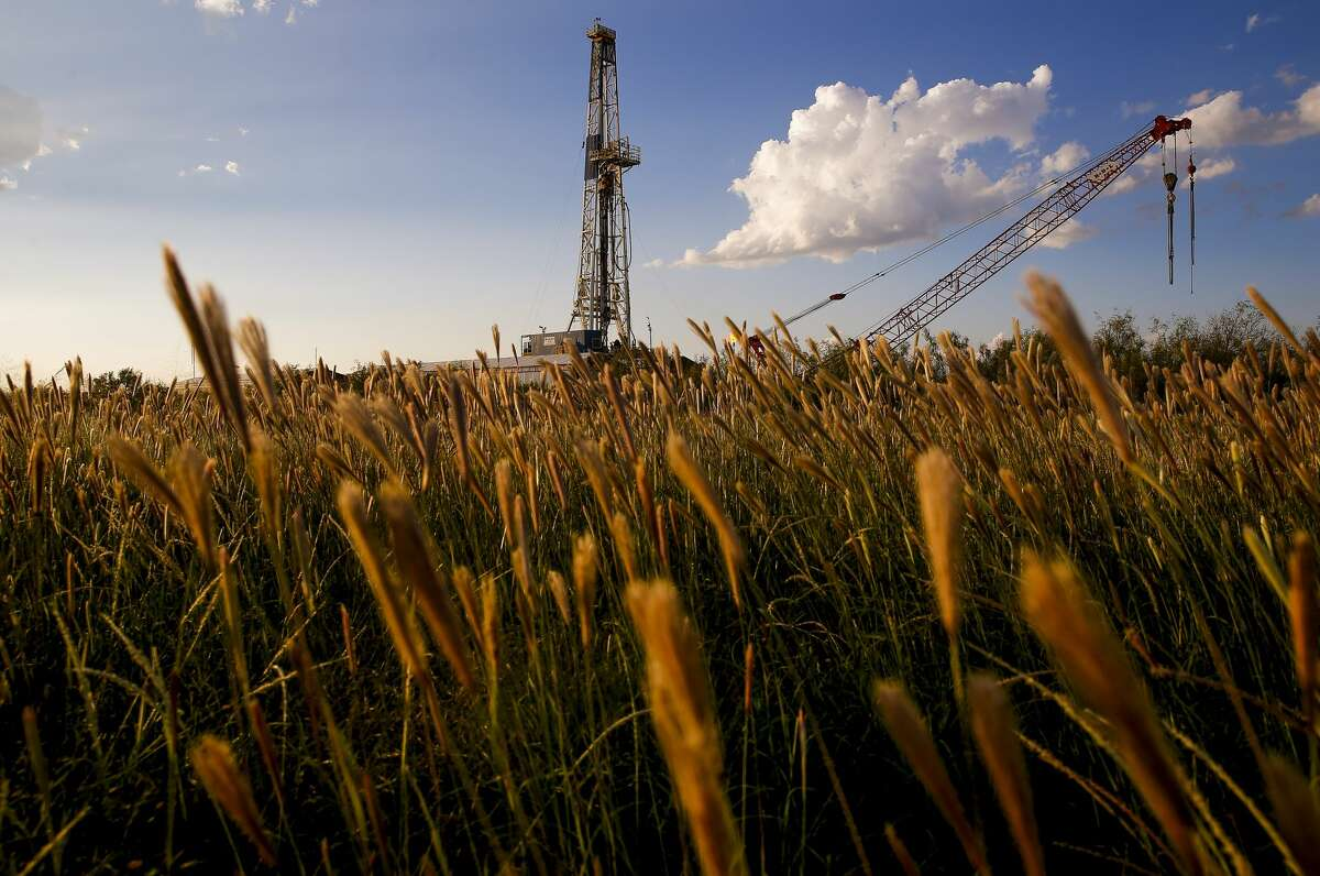 An Apache Corporation drilling rig sits north of the Davis Mountains Friday, Sept. 16, 2016 in Balmorhea. The company recently announced the discovery of an estimated 15 billion barrels of oil and gas in the area and plans to drill and use hydraulic fracturing on the 350,000 acres surrounding the town. Apache has leased the mineral rights under the town and nearby state park, but has promised not to drill on or under either. While some residents worry that the drilling could affect the spring at the state park and impact tourism, others are excited for the potential economic boom the oil discovery and drilling could bring. ( Michael Ciaglo / Houston Chronicle )
