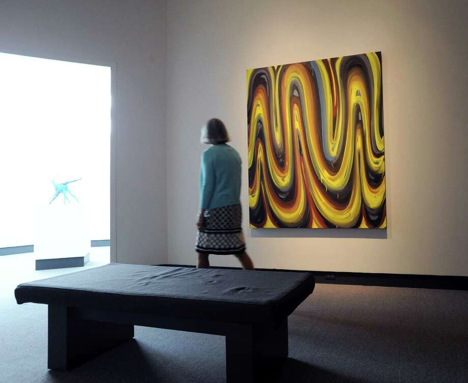"Cynthia Ehlinger of the Bruce Museum's marketing department, views the Karin Davie oil on linen painting done in 2001 titled ""Interior Ghosts #12,"" from the collection of Ann and Argyris Vassiliou that is part of the exhibition. Photo: Bob Luckey Jr. / Hearst Connecticut Media / Greenwich Time"