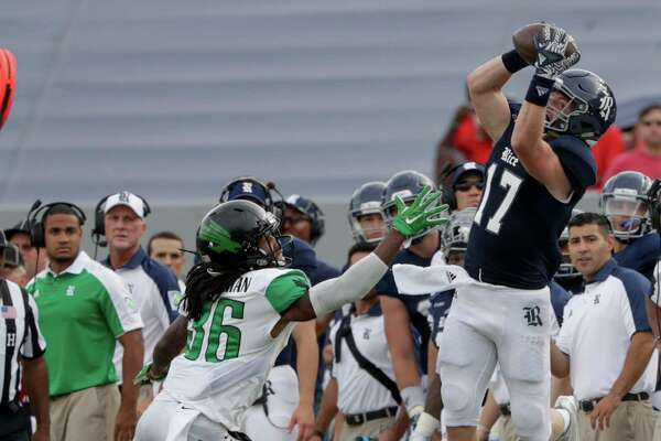 Rice Owls wide receiver Zach Wright (17) catches a pass on the sideline defended by North Texas Mean Green defensive back Dee Baulkman (36) during the NCAA football game between the North Texas Mean Green and the Rice Owls at Rice Stadium in Houston, TX on Saturday, September 24, 2016.  The Owls lead the Mean Green 17-14 at halftime.