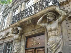 "Baroque architecture gives a stately beauty to Aix-en-Provence. Here two ""telamones"" � male figures used as columns � appear to hold up a balcony on Cours Mirabeau."