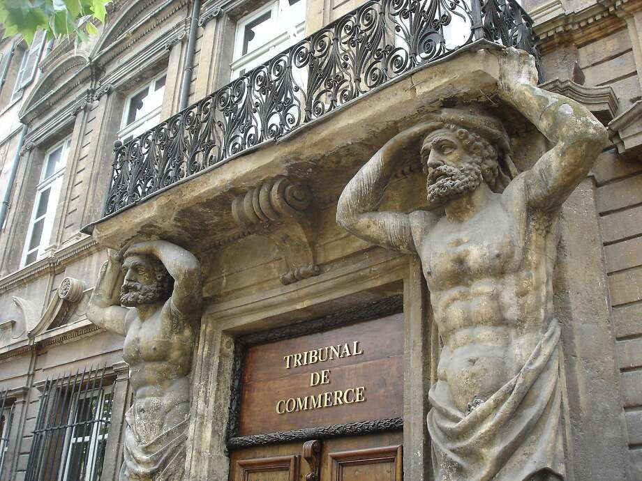 "Baroque architecture gives a stately beauty to Aix-en-Provence. Here two ""telamones"" — male figures used as columns — appear to hold up a balcony on Cours Mirabeau. Photo: Rick Steves"