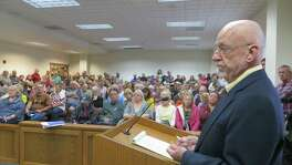 David Whitsett of Kerrville Freethought addresses a crowd of about 200 before Kerr County Commissioners on Monday. Most in the audience opposed his request to hang a banner outside the Kerr County Courthouse during the winter solstice, where a nativity scene is erected annually.