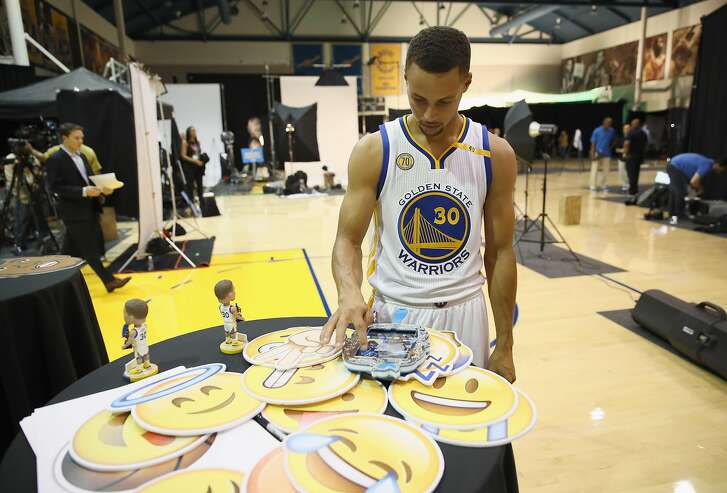 OAKLAND, CA - SEPTEMBER 26:  Stephen Curry #30 of the Golden State Warriors signs a tablet for the Warriors' social media team during the Golden State Warriors Media Day at the Warriors Practice Facility on September 26, 2016 in Oakland, California.  (Photo by Ezra Shaw/Getty Images)