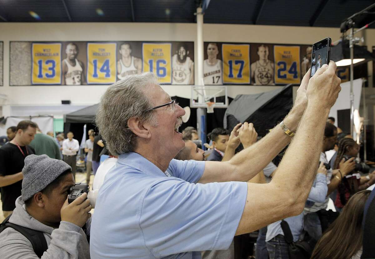 Warriors broadcaster and legend, Jim Barnett, gets in on the photo scrum during Warriors Media Day at their training facility in Oakland, Calif., on Monday, September 26, 2016.