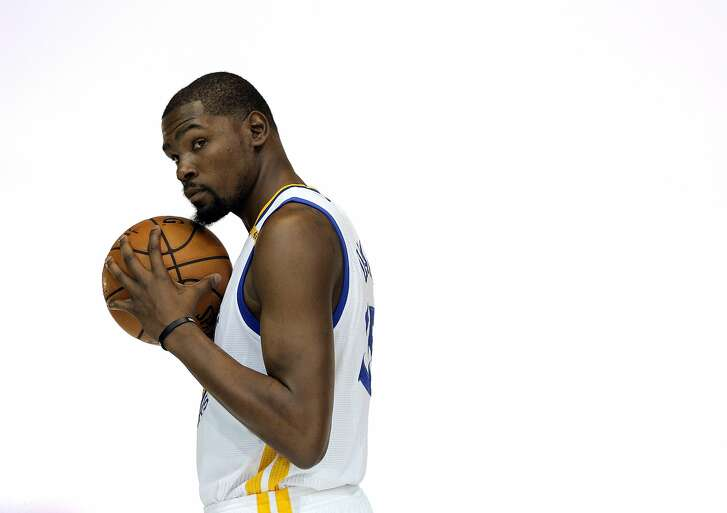 Kevin Durant (35) poses for a photo during Warriors Media Day at their training facility in Oakland, Calif., on Monday, September 26, 2016.