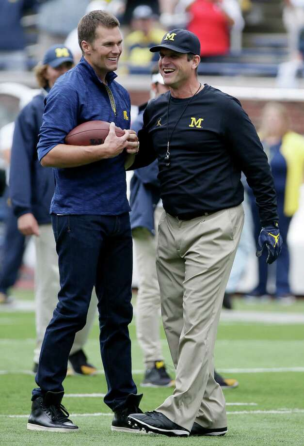 ANN ARBOR, MI - SEPTEMBER 17:  Quarterback Tom Brady of the New England Patriots laughs with head coach Jim Harbaugh of the Michigan Wolverines after they played catch before a game against the Colorado Buffaloes at Michigan Stadium on September 17, 2016 in Ann Arbor, Michigan. (Photo by Duane Burleson/Getty Images) ORG XMIT: 659652337 Photo: Duane Burleson / 2016 Getty Images