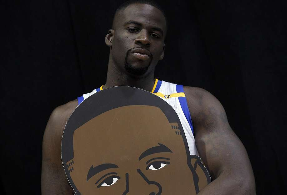 Draymond Green (23) holds his emoji head during Warriors Media Day at their training facility in Oakland, Calif., on Monday, September 26, 2016. Photo: Carlos Avila Gonzalez, The Chronicle