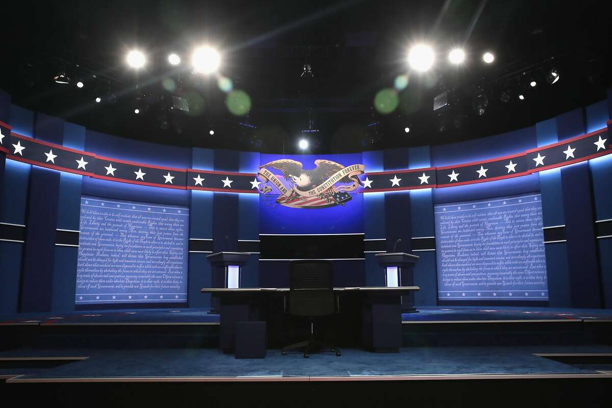 HEMPSTEAD, NY - SEPTEMBER 26: The stage is set ahead of the Presidential Debate between Democratic presidential nominee Hillary Clinton and Republican presidential nominee Donald Trump at Hofstra University on September 26, 2016 in Hempstead, New York. The first of four debates for the 2016 Election, three Presidential and one Vice Presidential, is moderated by NBC's Lester Holt. (Photo by Drew Angerer/Getty Images)