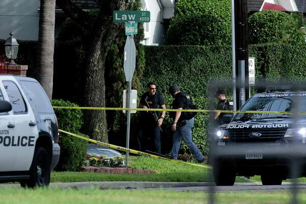 Police investigate the scene of a shooting along Wesleyan at Law Street that left multiple people injured and the alleged shooter dead, Monday morning, Sept. 26, 2016, in Houston. (Mark Mulligan/Houston Chronicle via AP)