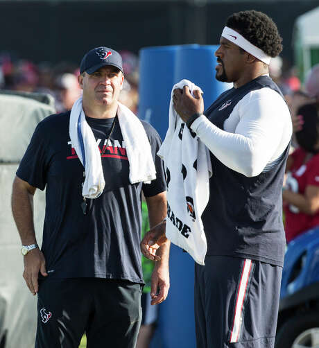 """Coach Bill O'Brien, left, says left tackle Duane Brown """"looked good"""" and is """"progressing well"""" after getting back on the practice field after almost nine months of inactivity. Photo: Brett Coomer, Staff / © 2016 Houston Chronicle"""