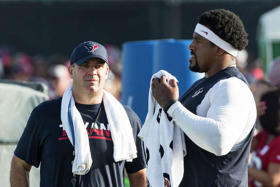 "Coach Bill O'Brien, left, says left tackle Duane Brown ""looked good"" and is ""progressing well"" after getting back on the practice field after almost nine months of inactivity."