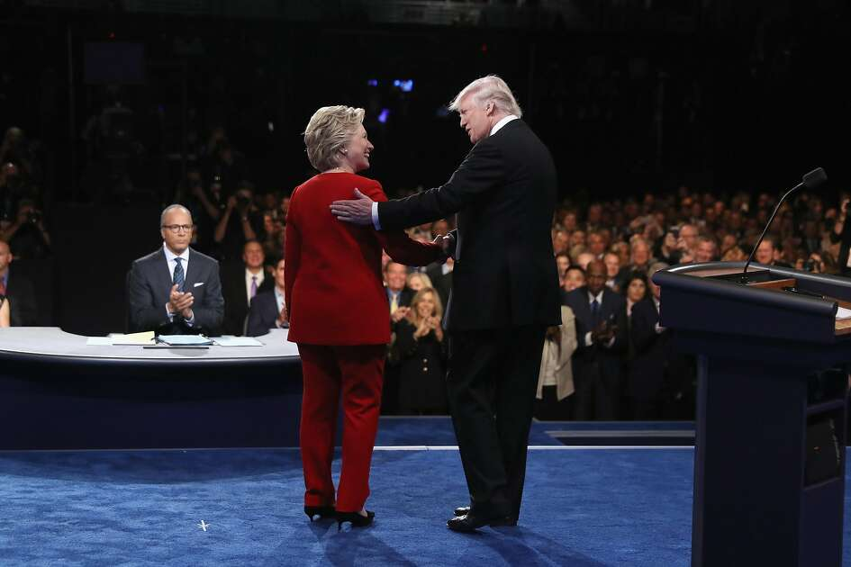 HEMPSTEAD, NY - SEPTEMBER 26:  Democratic presidential nominee Hillary Clinton shakes hands with Republican presidential nominee Donald Trump during the Presidential Debate at Hofstra University on September 26, 2016 in Hempstead, New York.  The first of four debates for the 2016 Election, three Presidential and one Vice Presidential, is moderated by NBC's Lester Holt.  (Photo by Joe Raedle/Getty Images)
