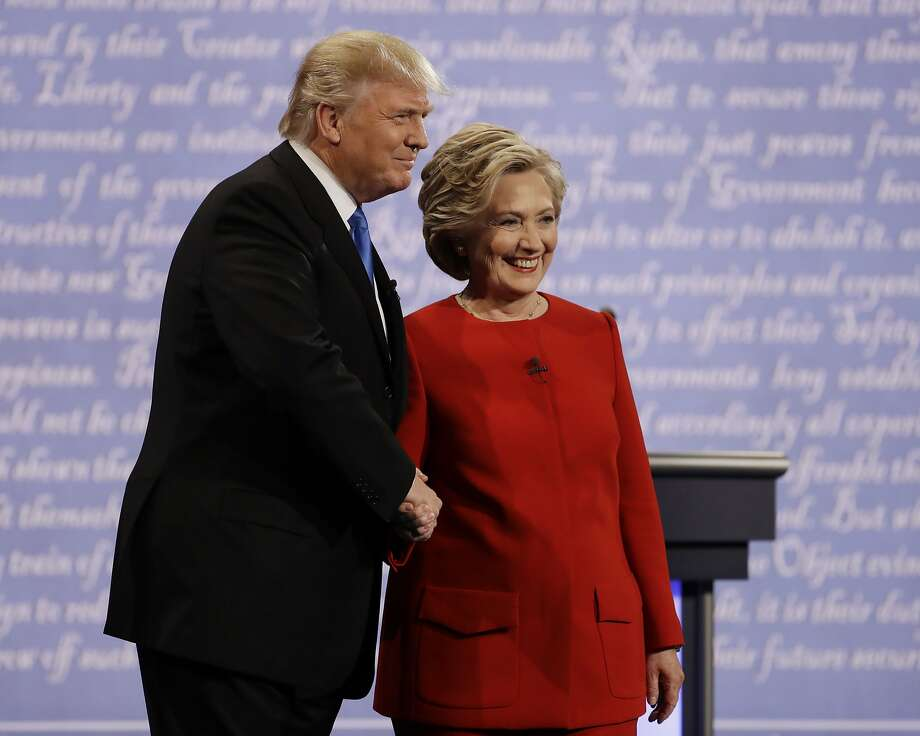 Democratic presidential nominee Hillary Clinton shakes hands with Republican presidential nominee Donald Trump during the presidential debate at Hofstra University in Hempstead, N.Y., Monday, Sept. 26, 2016. (AP Photo/Julio Cortez) Photo: Julio Cortez, Associated Press