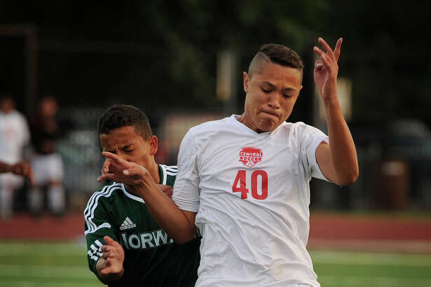 Bridgeport Central's Guilherme Basil, right, plays the ball in front of Norwalk's Sebastian Echeverri in Monday's FCIAC boys soccer match at Kennedy Stadium in Bridgeport.