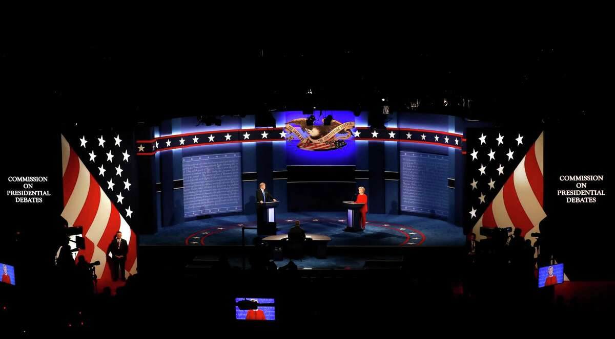 Democratic presidential nominee Hillary Clinton and Republican presidential nominee Donald Trump appear on stage during the presidential debate at Hofstra University in Hempstead, N.Y., Monday, Sept. 26, 2016. (AP Photo/Mary Altaffer)