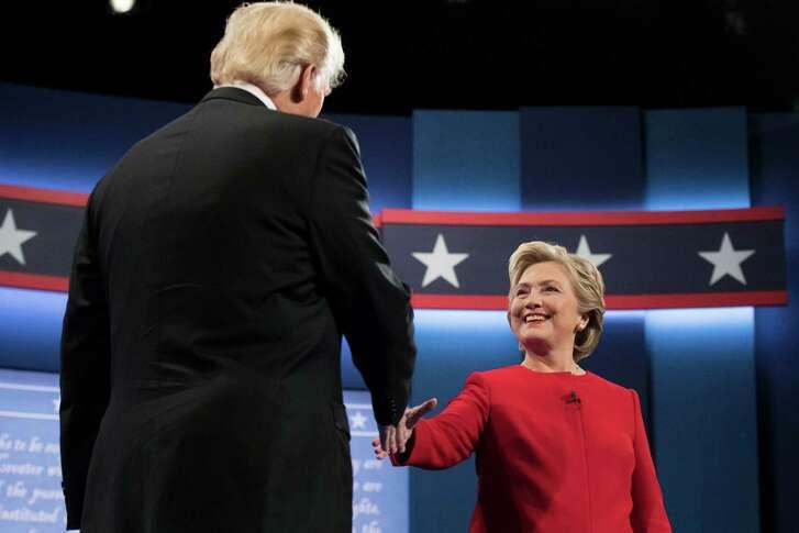 Republican presidential nominee Donald Trump shakes hands with Democratic presidential nominee Hillary Clinton during the presidential debate at Hofstra University in Hempstead, N.Y., Monday, Sept. 26, 2016. (AP Photo/Matt Rourke)