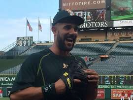 A's outfielder Andrew Lambo joins the A's during batting practice Friday in Anaheim after spending much of he season recovering from testicular cancer surgery.