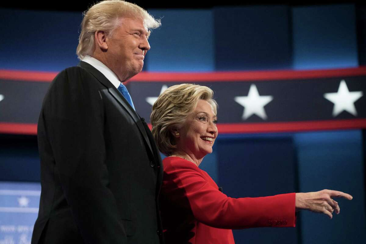 Democratic presidential candidate Hillary Clinton and Republican presidential candidate Donald Trump meet during the first presidential debate at Hofstra University in Hempstead, N.Y., Monday, Sept. 26, 2016. (AP Photo/Matt Rourke)