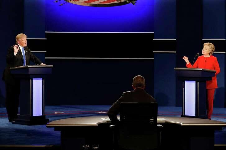 Republican presidential nominee Donald Trump and Democratic presidential nominee Hillary Clinton spar during the presidential debate at Hofstra University in Hempstead, N.Y., Monday, Sept. 26, 2016.