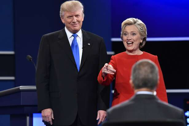 Democratic nominee Hillary Clinton (R) gestures  next to Republican nominee Donald Trump during the first presidential debate at Hofstra University in Hempstead, New York on September 26, 2016. / AFP PHOTO / Paul J. RichardsPAUL J. RICHARDS/AFP/Getty Images