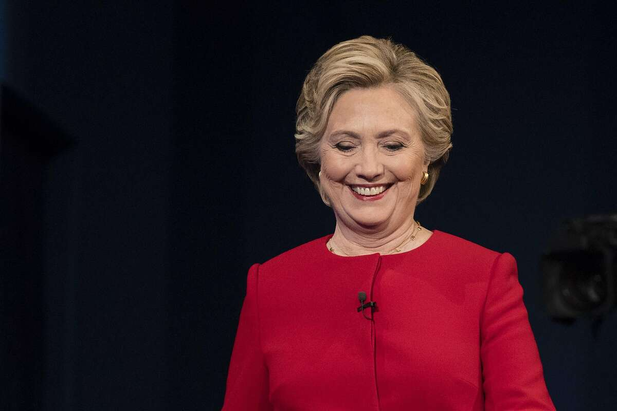 Democratic presidential candidate Hillary Clinton walks to meet Republican presidential candidate Donald Trump at the start of the first presidential debate at Hofstra University in Hempstead, N.Y., Monday, Sept. 26, 2016. (AP Photo/Matt Rourke)