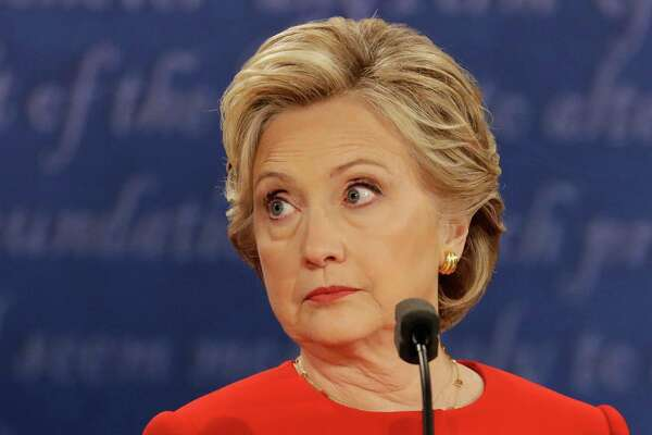 Democratic presidential nominee Hillary Clinton listens to Republican presidential nominee Donald Trump during the presidential debate at Hofstra University in Hempstead, N.Y., Monday, Sept. 26, 2016.