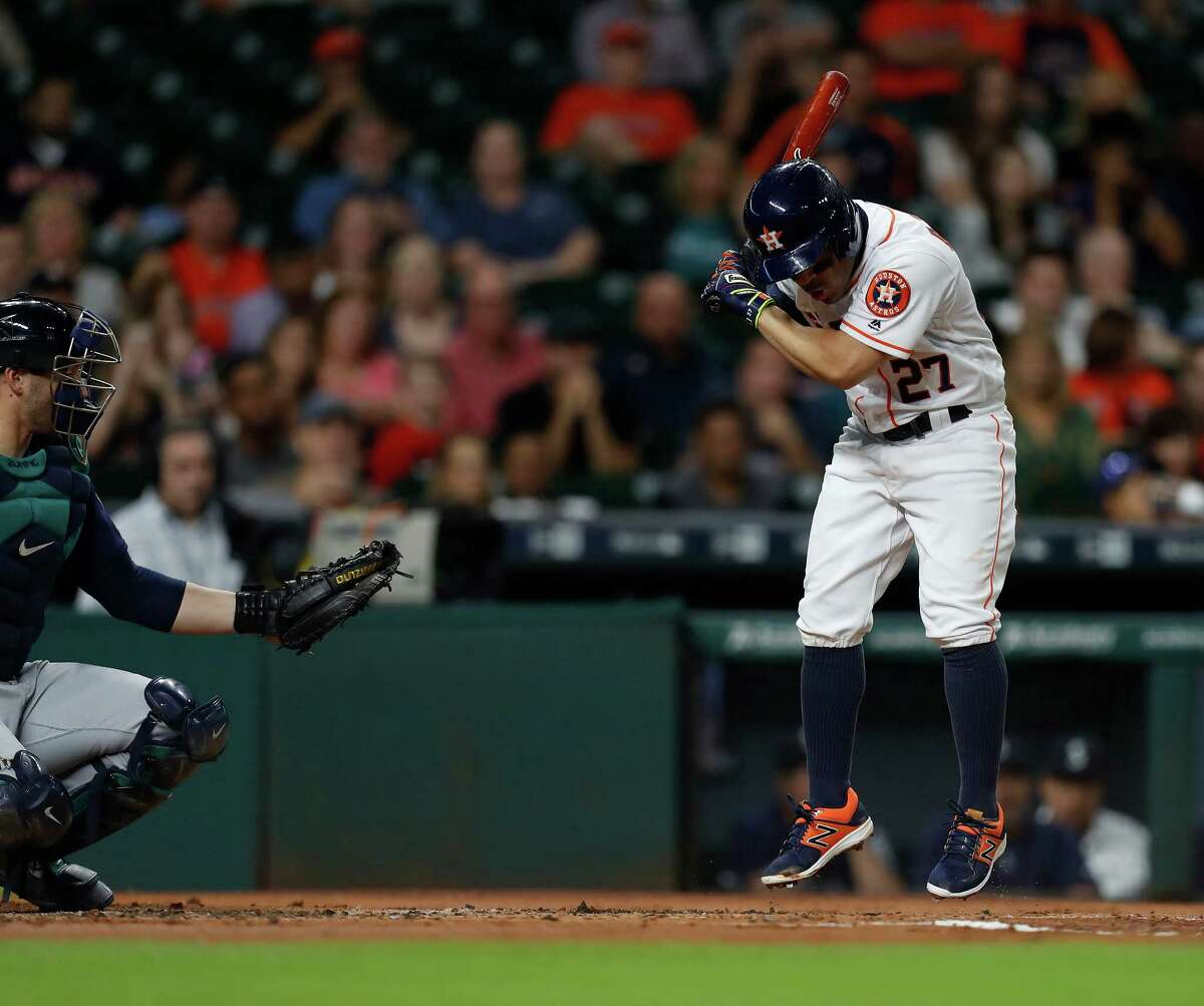 Sept. 26: Mariners 4, Astros 3 Houston Astros second baseman Jose Altuve (27) hops up on a pitch inside in the first inning of an MLB game at Minute Maid Park, Monday, Sept. 26, 2016 in Houston.