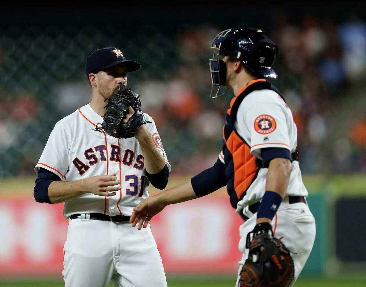 Houston Astros starting pitcher Collin McHugh (31) talks with catcher Jason Castro (15) in the first inning of an MLB game at Minute Maid Park, Monday, Sept. 26, 2016 in Houston.