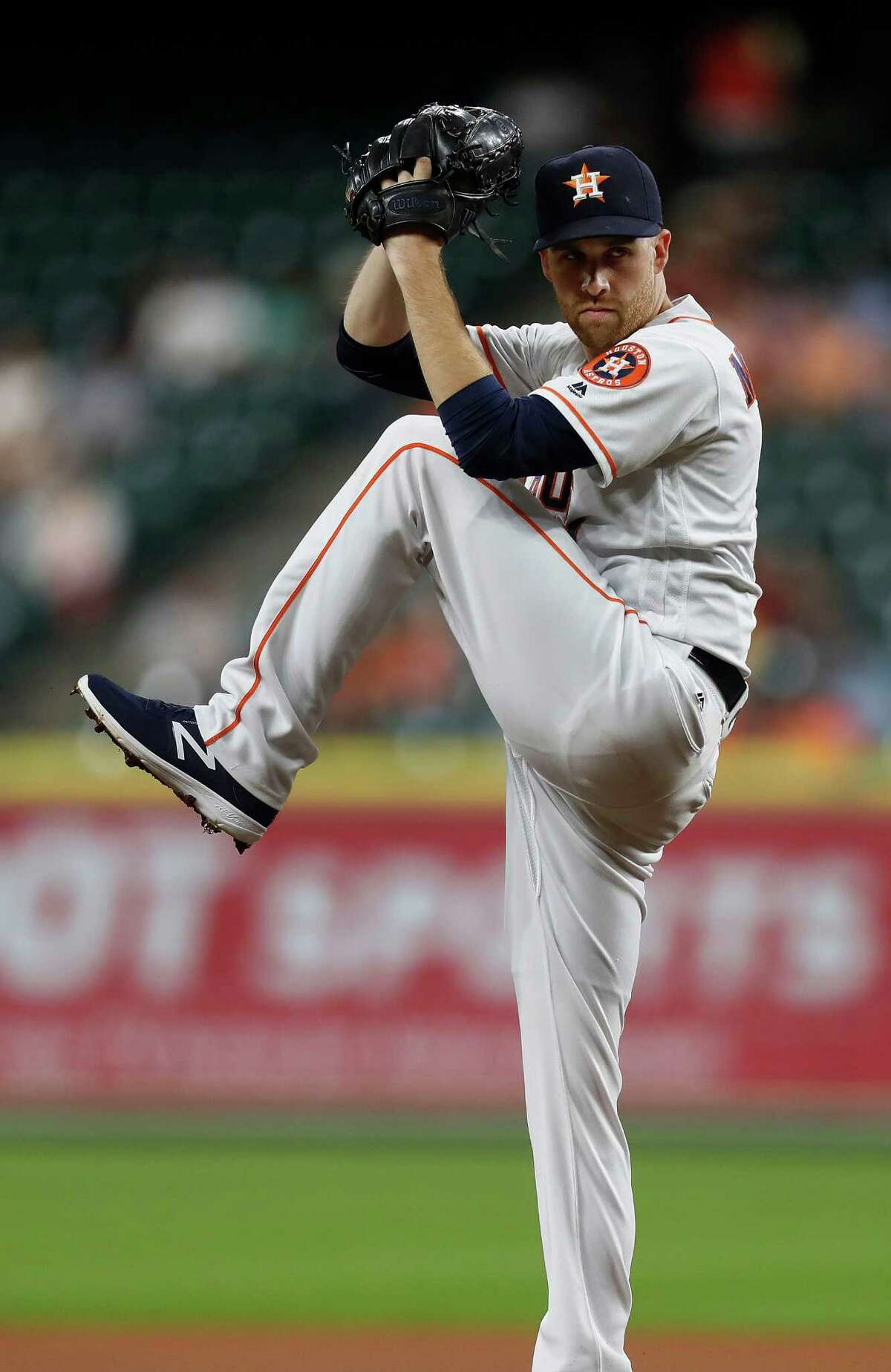 Houston Astros starting pitcher Collin McHugh (31) pitches in the first inning of an MLB game at Minute Maid Park, Monday, Sept. 26, 2016 in Houston.