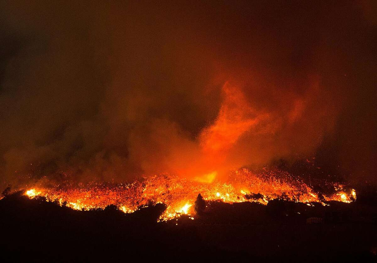 The Loma fire burns northwest of Morgan Hill, Calif., on Monday, Sept. 26, 2016.