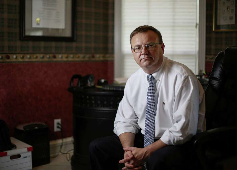 Keith Wood, a lawyer who was a victim of a jury duty scam, poses for a portrait in his home office, Friday, Sept. 23, 2016, in Houston. Photo: Jon Shapley, Houston Chronicle / © 2015  Houston Chronicle