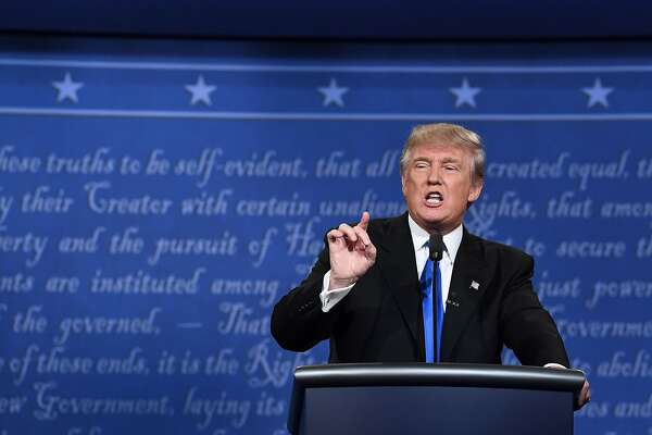 Republican nominee Donald Trump speaks during the first presidential debate at Hofstra University in Hempstead, New York on September 26, 2016. / AFP PHOTO / Jewel SAMADJEWEL SAMAD/AFP/Getty Images