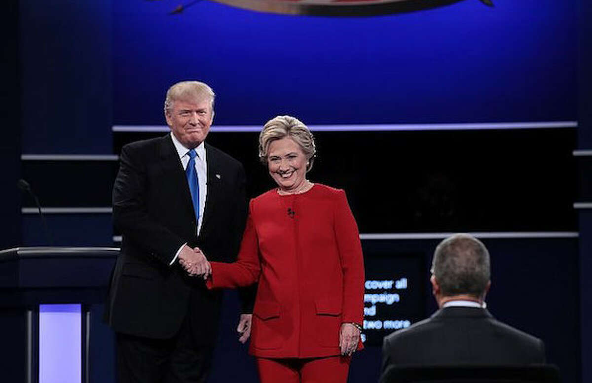 Hillary Clinton and Donald Trump grasped America's attention Monday night during their first presidential debate. Keep clicking to see Twitter's reactions during the debate.