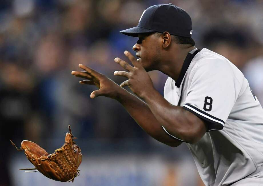 New York Yankees pitcher Luis Severino throws away his glove as he approaches Toronto Blue Jays' Justin Smoak after hitting him with a pitch during the second inning of a baseball game Monday, Sept. 26, 2016, in Toronto. (Frank Gunn/The Canadian Press via AP) ORG XMIT: FNG508 Photo: Frank Gunn / The Canadian Press