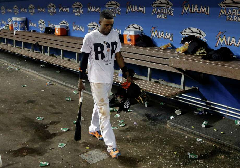 Miami Marlins' Dee Gordon wears a T-shirt reading RIP in honor of Marlins pitcher Jose Fernandez as he walks through the dugout after a baseball game against the New York Mets, Monday, Sept. 26, 2016, in Miami. Fernandez was killed in a boating accident early Sunday. The Marlins defeated the Mets 7-3. (AP Photo/Lynne Sladky) ORG XMIT: FLLS137 Photo: Lynne Sladky / Copyright 2016 The Associated Press. All rights reserved.