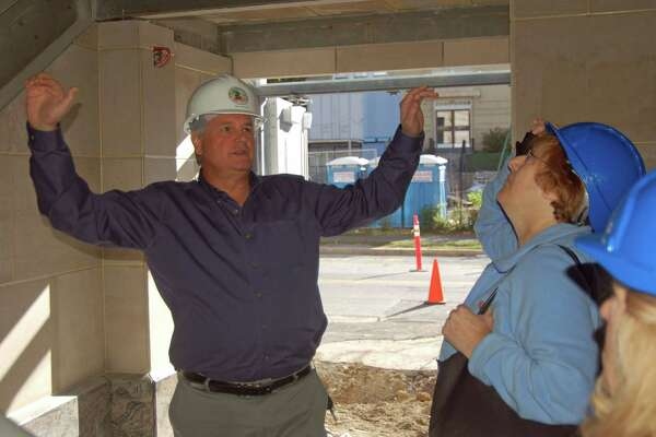 Town Superintendent of Buildings and Maintainence Alan Monelli discusses the new central fire station with BET members during a tour of the facility Monday.