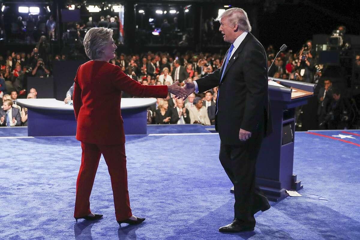 Democratic presidential nominee Hillary Clinton shakes hands with Republican presidential nominee Donald Trump after the presidential debate at Hofstra University in Hempstead, N.Y., Monday, Sept. 26, 2016. (Joe Raedle/Pool via AP)