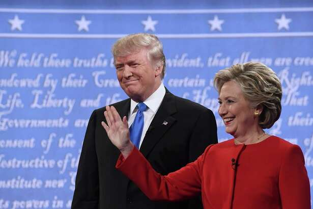 Democratic nominee Hillary Clinton (R) stands next to Republican nominee Donald Trump during the first presidential debate at Hofstra University in Hempstead, New York on September 26, 2016. / AFP PHOTO / Jewel SAMADJEWEL SAMAD/AFP/Getty Images